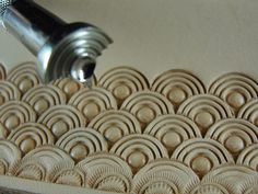 This is a Loop Shell Geometric Stamp. It is a great stamp for creating an interesting geometric design and it produces a great pattern. The impression of thi Leather Stamps, Leather Art, Custom Leather, Leather Design, Tooled Leather, Sewing Leather, Leather Working Tools, Leather Craft Tools, Leather Projects