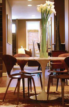 Love the Saarinen table over the cowhide rug.