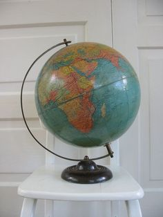 Globe - Vintage Globes & Maps i love vintage globes. and i love the idea of repurposing them [paint with chalkboard paint and add quotes; cut in half and make light fixture, bowl, etc. Old Globe, Globe Art, Globe Decor, Vintage Globe, Vintage Maps, Balinese Decor, Vintage Interiors, We Are The World, Distressed Painting