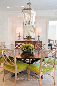 Love the green fabric on the dining chairs