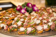 Prime Beef Tenderloin Bruschetta Served on Roasted Garlic Toast with Creamy Horseradish by Artichoke and Company. Photo by Peggy Farren
