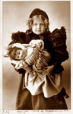 1898.. child and her doll. Notice the fab shoulder pads of the girl's coat!!