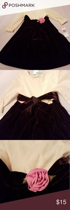 Laura Ashley Cream Maroon 2T Dress NWT Cream and Maroon (dark) NWT Laura Ashley velvet and lace dress in 2T. Features a pink satin rose in front and a velvet ribbon in back. Original tags are stuck together after price sticker residue from original purchase (sorry). Laura Ashley Dresses Formal