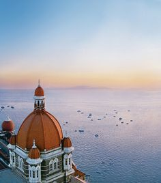 The wide expanse of the sea, the blue skies, the golden horizon and the crown of Mumbai's harbour-The dome of The Taj Mahal Palace, Mumbai. Tag us on pictures you have clicked near the Apollo at Taj with  #TajMahalMumbai