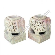 World Menagerie Carved from soapstone, two regal sculpture enhance the ambiance with candlelight and scents. The middle sections embrace removable soapstone cubes designed to hold tea lights, tapers, and pillar candles or incense sticks and cones.