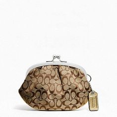 Coach Signature Frames Coin Purse, starting at $40.