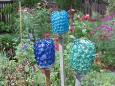 Made from used food jars, you can decorate them with flat-bottom marbles (or whatever you like), and place them in the garden.