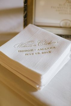 Elegant gold and white cocktail napkins, photo by Paige Winn Photo | via junebugweddings.com