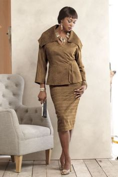 Lundy Skirt Suit from ASHRO  |  Square cutouts with solid black background on suit jacket collar, peplum and skirt. Wrap-style jacket features a wide portrait collar, self-fabric ties, peplum and 3/4 dolman sleeves. Side back elastic-waist skirt has side zipper.