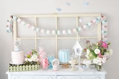 Styling and photo by Jessica of Prop Shop Boutique. Love the garland and the window backdrop. Perfect for Easter. Many more gorgeous photos to drool over.