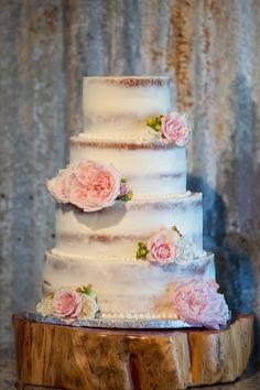 We love this rustic, nearly naked wedding cake! {@jennifergweems}