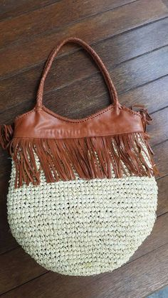 Check out this item in my Etsy shop https://www.etsy.com/listing/400024831/small-raffia-and-leather-fringe-tote