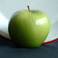Granny Smith Apples have tough, shiny green skin with dots that are usually white, though sometimes purplish.    The white flesh inside is firm, crisp and crunchy. The flavour is tangy, tart and sweet. And yes, there really was a Granny Smith. http://www.cooksinfo.com/granny-smith-apples