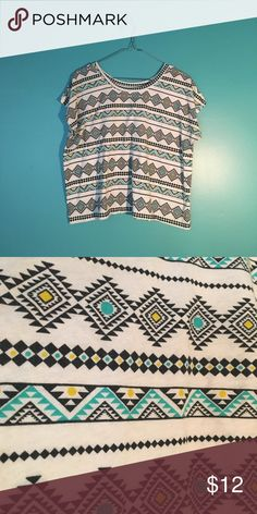 Bright Tribal Print Flowy Tee White Flowy tee with blue, yellow, and black tribal print. Great condition - like new. LOL Vintage Tops Tees - Short Sleeve