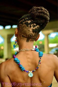 I love the idea of dreadlocks with a unique undercut. Great way to keep the locs versatile.