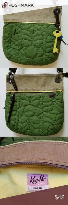 """Fossil Quilted Key-Per Crossbody Bag This Fossil bag is in EUC. It looks like it was never used.  It's quilted in a pretty floral design and has both interior and exterior zippered pockets.  Also has one inside slip pocket.  The adjustable canvas shoulder drop is 24"""" fully extended. Bag measures  approximately 11 1/2"""" tall X 11"""" wide.  Key-Per key and beads are in excellent condition. Fossil Bags Crossbody Bags"""