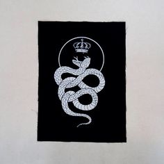 King Snake backpatch - sew on occult patch w. kings crown and curled up snake/cobra, black metal, handmade, screenprinted by InDroneArt on Etsy https://www.etsy.com/listing/257562272/king-snake-backpatch-sew-on-occult-patch