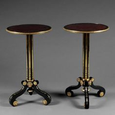 A PAIR OF EBONIZED MOUNTED TRIPOD TABLES PROBABLY BY THOMAS PARKER
