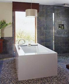 This is the tub I'd install under the window.  I would hang a girly chandelier over it, and place a round antique table next to it for a book and glass of wine.