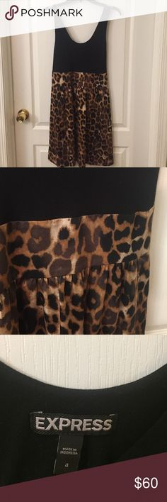 Express leopard tank dress Black tank top with leopard bottom. Side pockets, top is rayon, bottom is cotton and spandex. Comfortable and fun! Express Dresses Midi