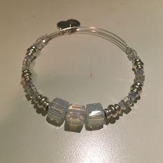 Alex and Ani Swarovski Crystal Expandable wire bangle made of Swarovski crystals... Clear/iridescent. One of a kind Alex & Ani Jewelry Bracelets