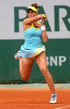 Monica Puig of Puerto Rico plays a forehand during her women's singles match against Nadia Petrova of Russia during day one of the French Open at Roland Garros on May 26, 2013 in Paris, France.