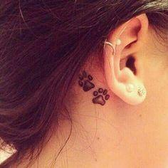 bijou d'oreille tatouage
