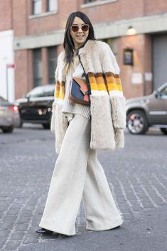 Colorful fur coat paired with wide-leg pants