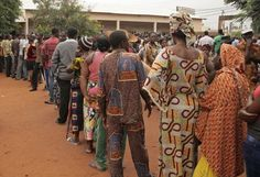 People stand in line to cast their ballots during the Togo legislative elections in the city of Lome, Togo, Thursday July 25, 2013