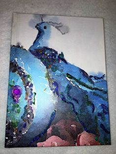 A personal favorite from my Etsy shop https://www.etsy.com/listing/474509546/fantasy-peacock-journal-bedazzled-6-x-8