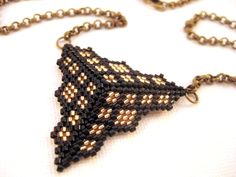 Peyote Triangle Pendant in Black and Gold by MadeByKatarina,