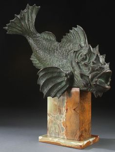ART DECO PATINATED BRONZE FIGURE OF AN EXOTIC FISH, CIRCA 1930. Signed R. Tornati, and resting on its original onyx base.