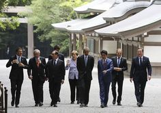 ISE, JAPAN - MAY 26: (From L) Italian Prime Minister Matteo Renzi, European Commission President Jean-Claude Juncker, French President Francois Hollande, Canadian Prime Minister Justin Trudeau, German Chancellor Angela Merkel, US President Barack Obama, Japanese Prime Minister Shinzo Abe, European Council President Donald Tusk and British Prime Minister David Cameron walk past the Kaguraden as they visit Ise-Jingu Shrine during the first day of the G7 leaders summit in the city of Ise in…