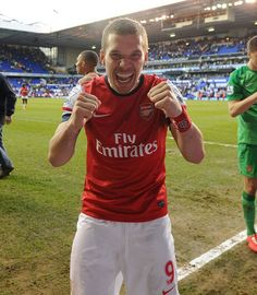 Aha! Poldi celebrating after the arsenal handed the hotspurs a loss