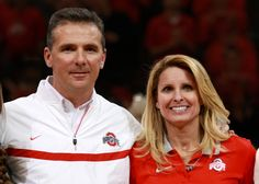 Ohio State Head Coach Urban Meyer and his wife Shelley Meyer, who is wearing a beautiful Sparkle Life necklace with red and grey beads. #sparklelife #sparkleon #buckeyes