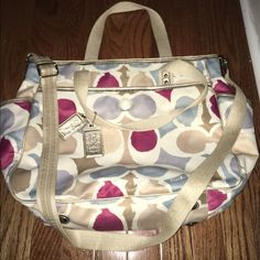 Coach diaper bag Might consider selling for the right price. I am not into couch anymore but I just loooove this piece.Pretty big Coach diaper bag. Excellent condition. Comes with changing pad and dust bag. Please no trades. Coach Bags Baby Bags