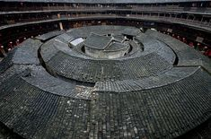 Traditional Chinese Fujian Tulou House - The City of Shamballa-Fujian Tulou houses are a type of Chinese rural dwelling which can be found in the mountainous region of southeastern Fujian, China. Most of the buildings were erected between the and century. China Architecture, Vernacular Architecture, Zhuhai, Xiamen, Round House, China Travel, Guangzhou, Beautiful Buildings, Facade