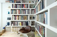 contemporary library, chunky white book shelves