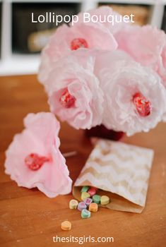 Lollipop Bouquet | Use coffee filters and lollipops to make this cute Valentine's DIY gift or party decoration.  via @sitsgirls