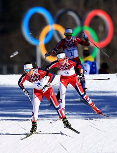 (R-L) Marit Bjoergen gold and Heidi Weng bronze of Norway compete in the Ladies' Skiathlon 7.5 km Classic + 7.5 km Free.