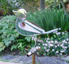 stained glass garden | Stained glass joined together to create a pretty garden art bird ...