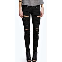 Boohoo Blue Evie Low Rise Extreme Shredded Skinny Jeans (47 CAD) ❤ liked on Polyvore featuring jeans, pants, black, distressed boyfriend jeans, black high waisted jeans, distressed skinny jeans, black skinny jeans and black ripped jeans
