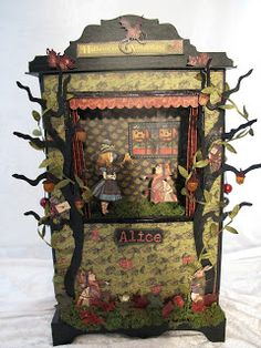 a puppet theatre card, box? made of cereal box, with paper puppets fixed in place. It would make an interesting real size theatre