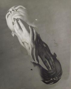 "Erwin Blumenfeld, ""Half Solarized Face""  http://www.modernisminc.com/artists/Erwin_BLUMENFELD/Half_Solarized_Face.html"