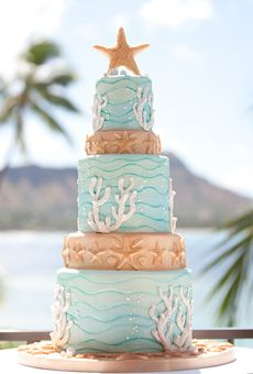 Beach wedding cake idea: Five-tiered ocean-inspired cake with a starfish topper