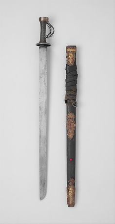 Sword and Scabbard Date: 18th–19th century Culture: Eastern Tibetan Medium:  Iron, copper alloy, wood, ray skin, leather, turquoise, coral, glass