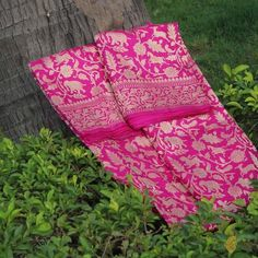 A rich and luxurious Shikaargah handloom saree. Zari vines, animal motifsand intricate jungle scenes make this a piece of woven art. An ode to handloom and a true Banarasi masterpiece. Color- A ravishingshade ofIndian Pink Technique- Classic handwoven Banarasi art passed down through generations Fabric- Soft as b