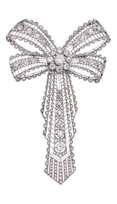 A circa 1920 diamond brooch. The double loop bow centring a flowerhead motif terminating in an articulated ribbon tassel, pierced and millegrain-set with old European-cut and rose diamonds together weighing approximately 4.45 carats, mounted in platinum, length approximately 85mm.