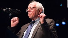 Democratic presidential candidate Bernie Sanders gestures while speaking at a campaign rally, March 23, 2016 at the Wiltern Theater in Los Angeles, California. / AFP / ROBYN BECK        (Photo credit should read ROBYN BECK/AFP/Getty Images)