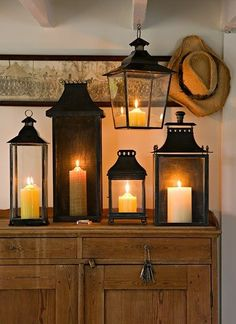 lit lanterns on console table
